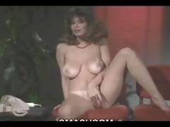 christy canyon masturbates with a large vibrator