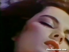 breasty retro chick masturbates in ottoman